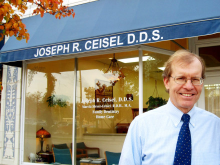 Dr. Ceisel in front of the office